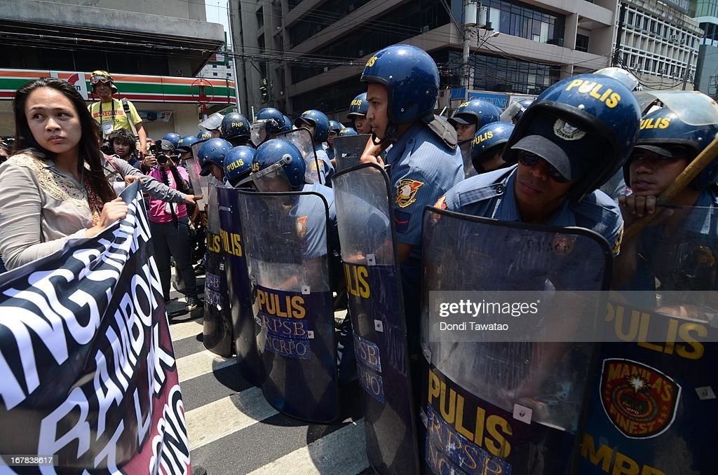 Protestors are stopped by anti riot police during their march towards the United States Embassy on May 1, 2013 in Manila, Philippines. Philippine workers unions gather in the streets of Manila to demand, among other things, better pay, an end to contractualization and layoff and the lowering of prices of basic commodities. Labor day is celebrated across South East Asia on May 1st and is seen as an opportunity to acknowledge the social and economic accomplishments of the workers.