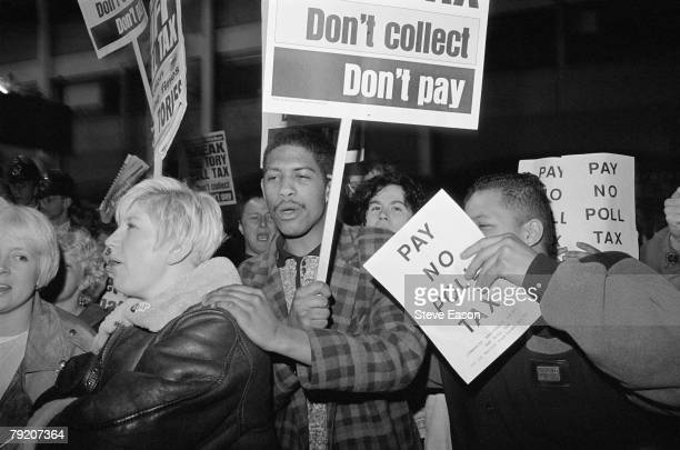 Protestors at a demonstration against the Poll Tax Brixton London 29th March 1990