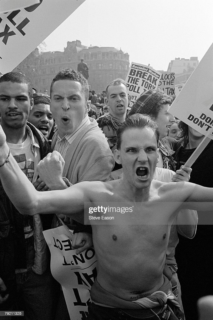 Protestors at a demonstration against the Poll Tax, which later became a riot known as the 'Battle of Trafalgar', London, 31st March 1990.