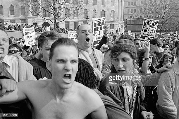 Protestors at a demonstration against the Poll Tax which later became a riot known as the 'Battle of Trafalgar' London 31st March 1990