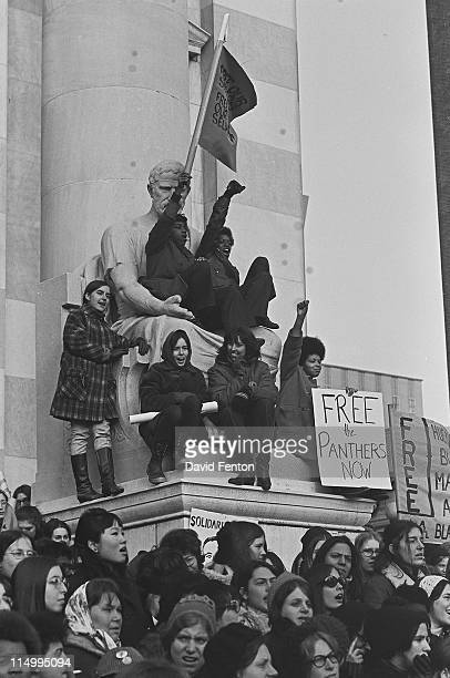 Protestors at a rally for Black Panthers raise closed fists in salute and hold signs stating 'Free the Panthers Now' New Haven CT November 1969
