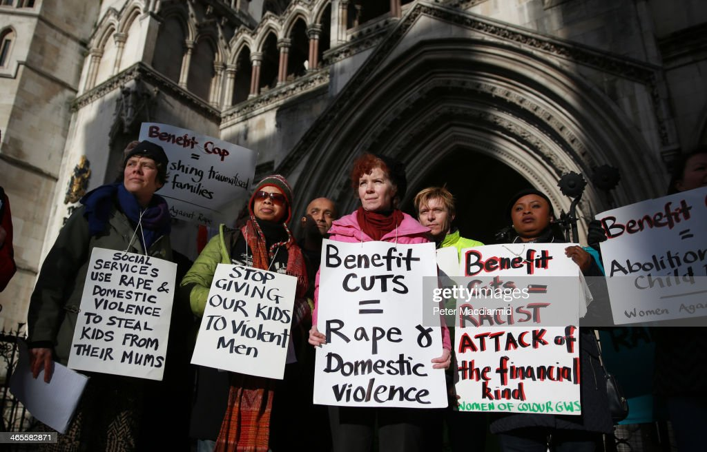Protestors at The Royal Courts of Justice call for an end to the benefit cap on January 28, 2014 in London, England. Three families are challenging the Government's policy of capping benefits at £500 per week.