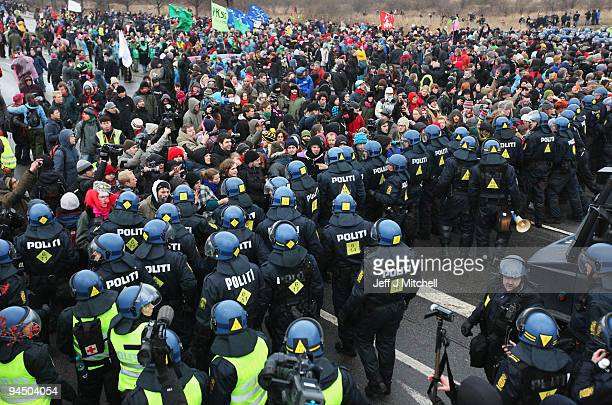 Protestors attempt to break through police lines outside the Bella Centre where the UN climate summit is taking place on December 16 2009 in...