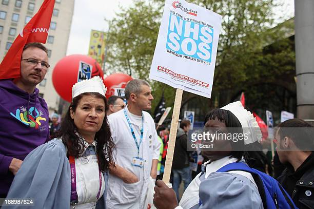 Protestors attend a demonstration against privatisation of the National Health Service on May 18 2013 in London England Demonstrators from various...