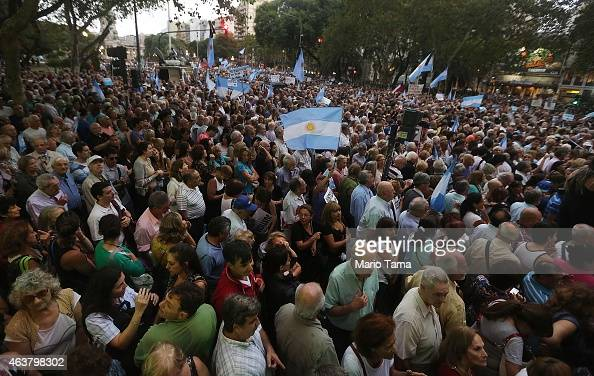 Protestors attend a 'Silent March' marking the onemonth anniversary of the suspicious death of special prosecutor Alberto Nisman on February 18 2015...