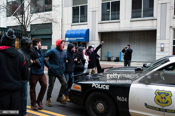 Protestors block police cruisers on Ontario Street December 21 in Cleveland Ohio Demonstrators marched through downtown protesting the death of...