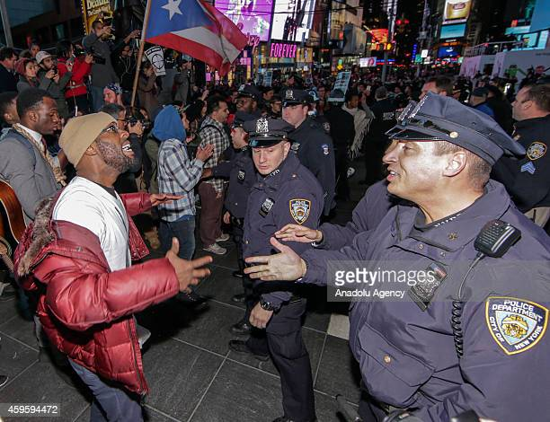 Protestors blocking the 5th Avenue argue with the police during the protests in New York City on November 25 2014 after the grand jury announcement...