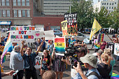 Protestors both supporting and opposing samesex marriage gather in front of the federal courthouse September 3 2015 in Ashland Kentucky Kim Davis the...