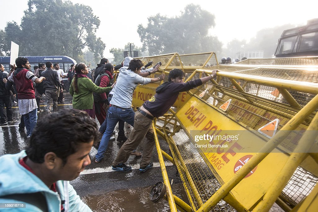 Protestors break down a barricade as Delhi police use work to disperse protestors during a protest against the Indian governments reaction to recent rape incidents in India, in front of India Gate on December 23, 2012 in New Delhi, India. The gang rape of a 23-year-old paramedical student in a moving bus on December 16, in Delhi, has led to people to react openly against the governments current rape laws. Over a thousand protesters gathered in front of Delhi to protest against lax laws and the governments handling of recent rape cases all over India.