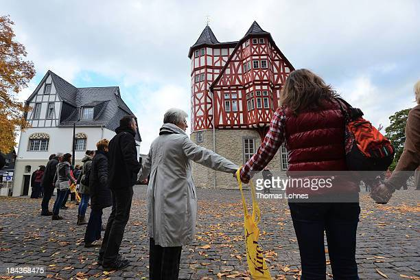 Protestors build a human chain from the the cathedral to the new residence of the bishop to protest against the bishop of Limburg on October 13 2013...