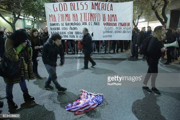 Protestors burn a US flag during a demonstration against the visit of the US president in Thessaloniki on November 15 2016 US President Barack Obama...