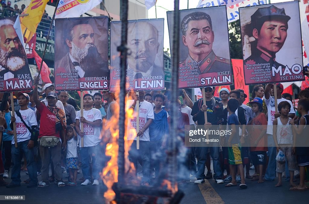 Protestors burn an effigy during their march near the presidential palace on May 1, 2013 in Manila, Philippines. Philippine workers unions gather in the streets of Manila to demand, among other things, better pay, an end to contractualization and layoff and the lowering of prices of basic commodities. Labor day is celebrated across South East Asia on May 1st and is seen as an opportunity to acknowledge the social and economic accomplishments of the workers.