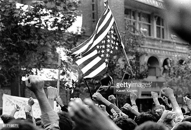 Protestors burn the US flag during a demonstration outside the US embassy in Tehran after it was seized by revolutionary students 11th November 1979
