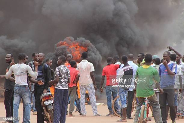 Protestors burn tires to block the roads during protests against a coup in Ouagadougou Burkina Faso on17 September 2015 Protests have sparked in...