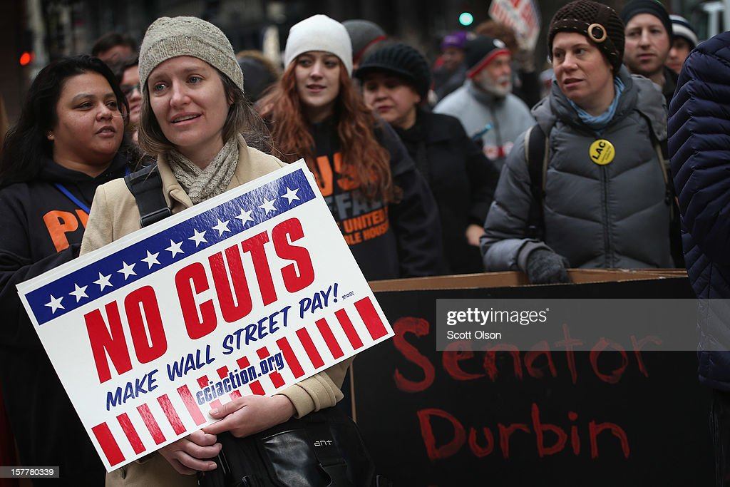 Protestors call for an increase of taxes on the wealthy and voice opposition to cuts in Social Security, Medicare, and Medicaid during a demonstration in the Federal Building Plaza on December 6, 2012 in Chicago, Illinois. About 300 protestors participated in the demonstration which resulted in three arrests.