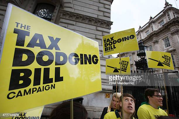 Protestors calling for a bill to stop tax dodging stand outside Downing Street on May 9 2015 in London England Prime Minister David Cameron is...