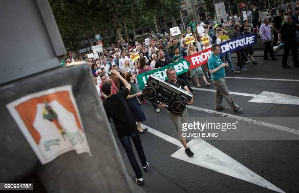 Protestors carry a banner reading 'United against dictatorship' during a protest against the Serbia's new President in Belgrade on May 31 2017...