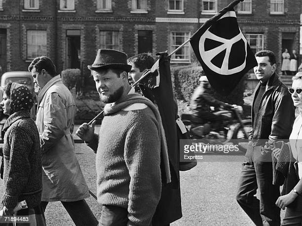 Protestors carry a CND flag on a march from Aldermaston Atomic Weapons Research Establishment to London April 1960