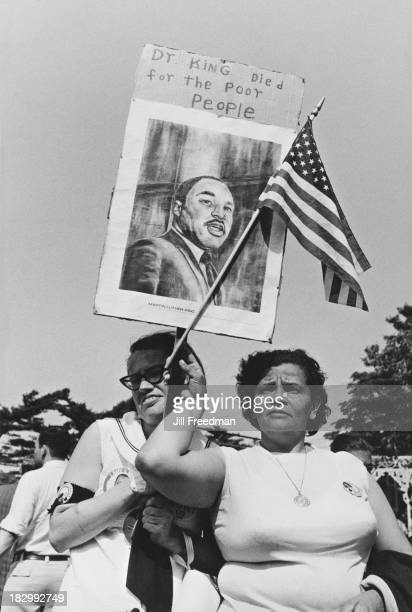 Protestors carry a picture of Martin Luther King Jr on the 'Solidarity Day' rally during the Poor People's Campaign an organised demonstration hoping...