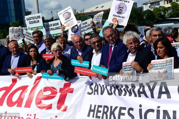Protestors carry placards and copies of the Cumhuriyet daily during a demonstration in front of Istanbul's court house on September 25 2017 during a...