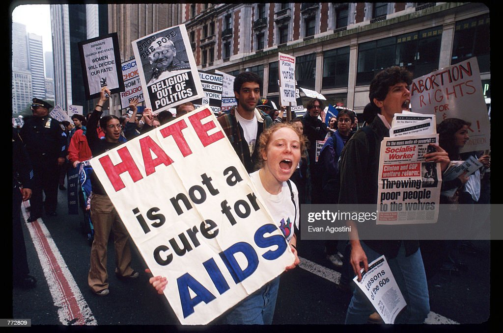 Protestors carry signs at the Women's Rights rally October 7 1995 in New York City The rally protested the arrival of Pope John Paul II whose...