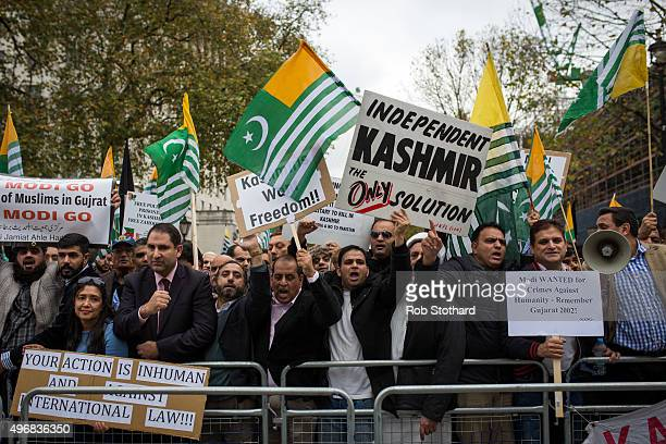 Protestors chant and wave the flag of Azad Jammu and Kashmir a selfgoverning administrative division of Pakistan during a protest on Whitehall...