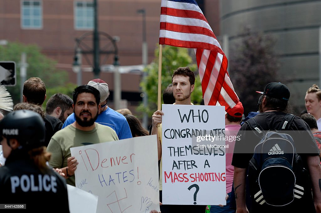 Protestors chant during an Anti-Trump rally at the corner of 14th and California in Denver, Colorado on June 1, 2016.