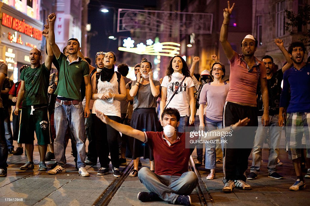 Protestors chant slogans on July 14, 2013 on Istiklal Avenue in the center of Istanbul. Turkish riot police fired rubber bullets, tear gas and water cannon to disperse hundreds of protesters trying to enter an Istanbul square that was the cradle of deadly unrest that engulfed the country in June. The police moved in when demonstrators protesting in the city's Beyoglu neighborhood against Prime Minister Recep Tayyip Erdogan moved toward nearby Taksim Square.