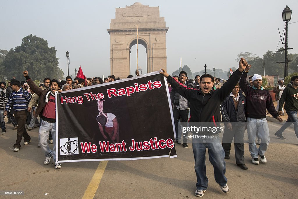 Protestors chants slogans during a protest against the Indian governments reaction to recent rape incidents in India, in front of India Gate on December 23, 2012 in New Delhi, India. The gang rape of a 23-year-old paramedical student in a moving bus on December 16, in Delhi, has led to people to react openly against the governments current rape laws. Over a thousand protesters gathered in front of Delhi to protest against lax laws and the governments handling of recent rape cases all over India.