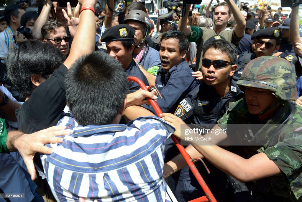 Protestors clash with police and military soldiers during anti coup protests on May 25, 2014 in Bangkok, Thailand. A small group of anti-coup protestors clashed with police and military in central Bangkok on the third day since martial law was declared and a coup de'etat was announced by the military. With other protests slowly building around the city tensions may start to rise if the stand off continues between the military and the people.