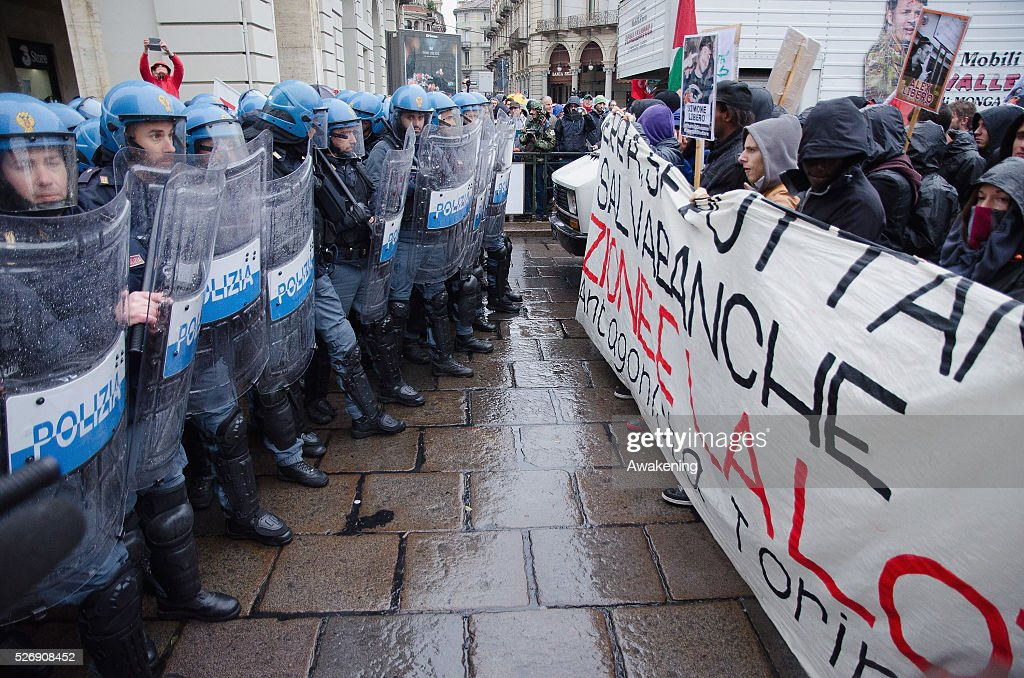 Protestors clash with police during May Day protests on May 01, 2016 in Turin, Italy. Police clashed with protestors as hundreds took to the streets to participate in May Day marches and gatherings across Italy, with many demonstrators demanding a solution to the migrant crisis.
