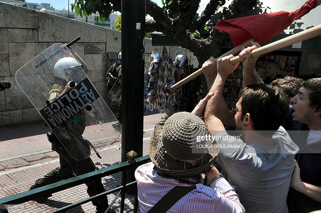 Protestors clash with riot police by the Greek Parliament in Athens on May 4, 2010. Demonstrators stormed the Athens Acropolis on Tuesday and civil servants launched a walkout ahead of a general strike against massive austerity spending cuts.With the government demanding painful 'sacrifices' after the country secured a 110 billion euro (145 billion dollar) debt bailout, Labour Minister Andreas Loverdos said: 'We have only one aim, to save Greece, and we are not going to budge.' AFP PHOTO / Louisa Gouliamaki