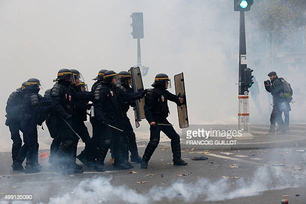 Protestors clash with riot police during a rally against global warming on November 29 2015 in Paris a day ahead of the start of UN conference on...