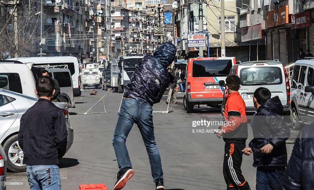 TOPSHOT Protestors clash with Turkish police during a demonstration against government imposed curfews imposed on areas of eastern Turkey on February...