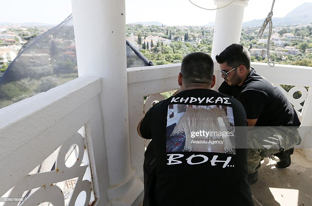 Protestors climbs to bell tower of the Agios Markos Church to hang a black fire after the cancellation of 'the rocker war' in Chios Island, Greece on April 30, 2016. Greek Orthodox Easter celebration 'Rocket War' which takes place between two local churches of Panaghia Erithiani and Aghios Marko at the Vrontados village is cancelled after some villagers had complained about the fireworks.