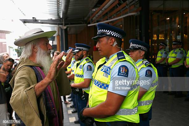 Protestors confront the police outside the Sky City Convention Centre ahead of the TPP signing on February 4 2016 in Auckland New Zealand The signing...