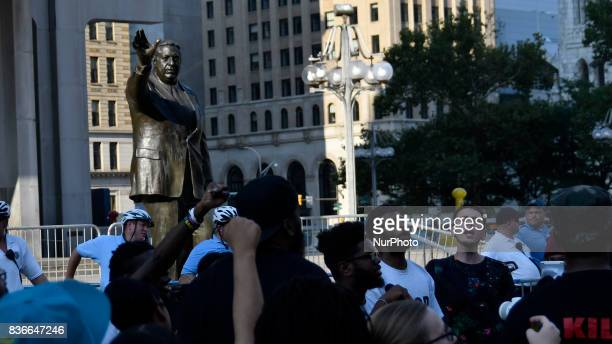 Protestors demand the removal of the Frank Rizzo statue at a rally near City Hall in Philadelphia PA on August 21 2017