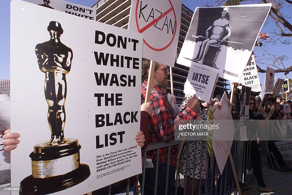 Protestors demonstrate 21 March 1999 in Los Angeles against the Lifetime Achievement Award to be presented to US film director Elia Kazan during the 71st Annual Academy Awards. The award to Kazan, who directed 'On the Waterfront', has angered many stars who recall how he destroyed careers when he 'named names' before the US House Un-American Activities Committee's infamous 1950's probe of communists in Hollywood. (ELECTRONIC IMAGE) AFP PHOTO/Hector MATA