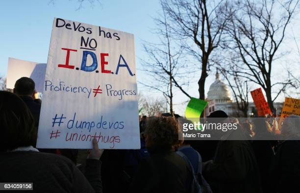 Protestors demonstrate against President Trump's nominee for secretary of education Betsy DeVos on Capitol Hill on February 6 2017 in Washington DC...
