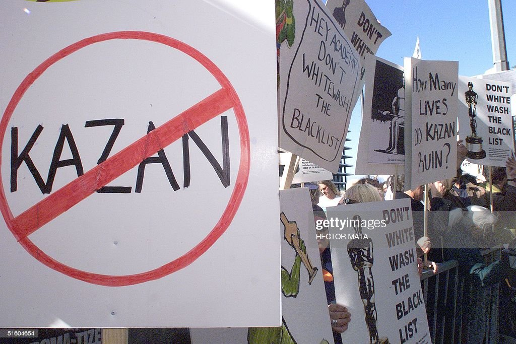 Protestors demonstrate against the Lifetime Achievement Award to be presented to US film director Elia Kazan at the 71st Annual Academy Awards in Los Angeles 21 March 1999. The award to Kazan, who directed 'On the Waterfront', has angered many stars who recall how he destroyed careers when he 'named names' before the US House Un-American Activities Committee's infamous 1950's probe of communists in Hollywood. (ELECTRONIC IMAGE) AFP PHOTO/Hector MATA