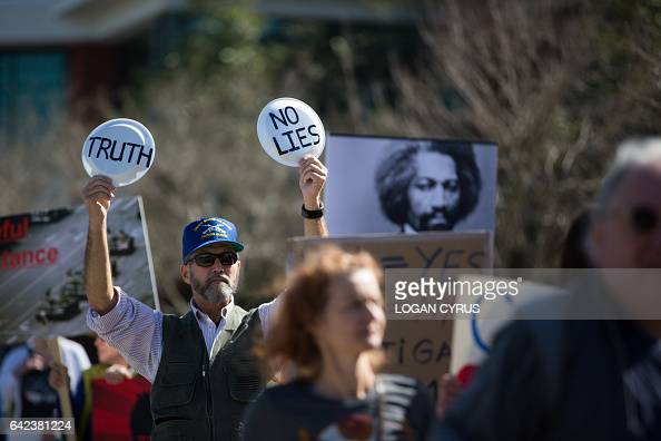 Protestors demonstrate at the designated protest area outside of the North Charleston Coliseum near the Charleston International Airport in North...