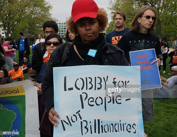 Protestors demonstrate at the US Capitol addressing income inequality minimum wage and ending tax breaks for wealthy corporations on Monday April 28...