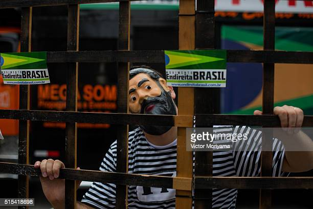 Protestors demonstrate demanding the removal of President Dilma Rousseff on March 13 2016 in Sao Paulo Brazil Demonstrations across the country today...