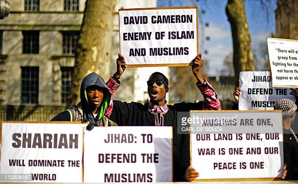 Protestors demonstrate in favour of Sharia law for Libya outside 10 Downing Street in London on March 21 2011 British Prime Minister David Cameron...