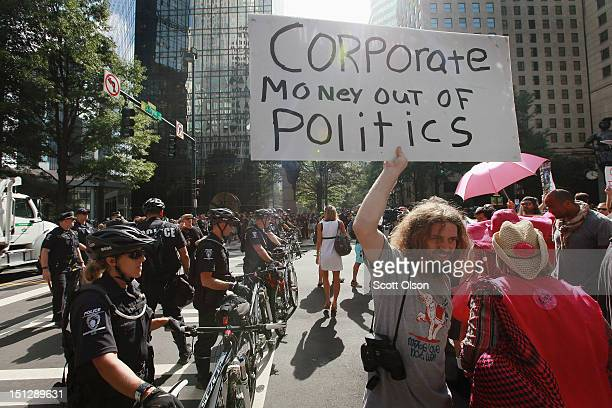 Protestors demonstrate in front of the Bank of America Headquarters in uptown during the Democratic National Convention September 5 2012 in Charlotte...