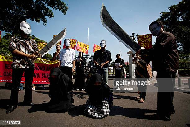 Protestors demonstrate in front of the Presidential Palace claiming the Indonesian Government are failing to protect its migrant workers following...