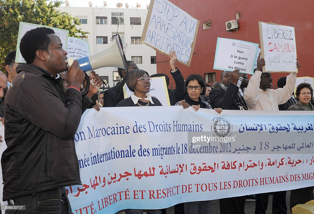 Protestors demonstrate outside a court in Rabat against the trial of Camara Laye, the founder of the Council of Sub-Saharan migrant in Morocco (CMSM), who was tried for illegally selling alcohol and cigarettes, on December 18, 2012. According to the police, Camara was arrested in the night of October 20 to October 21, 2012 at his home where police found three bottles of wine and two cartons of cigarettes. PHOTOS