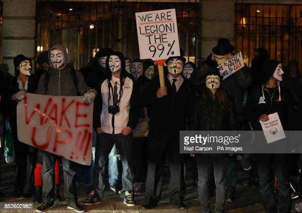 Protestors demonstrate outside Leinster House in Dublin as part of a planned Anonymous Million Mask March to mark Guy Fawkes Day