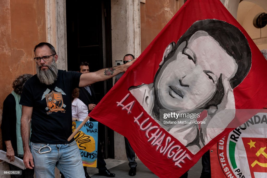Protestors demonstrate solidarity for president of Venezuela Nicolas Maduro and the people of the Bolivarian Republic of Venezuela, against the external interference of USA, OSA, EU and their allies and against the violence of the right coup in Venezuela on May 17, 2017 in Rome,Italy.