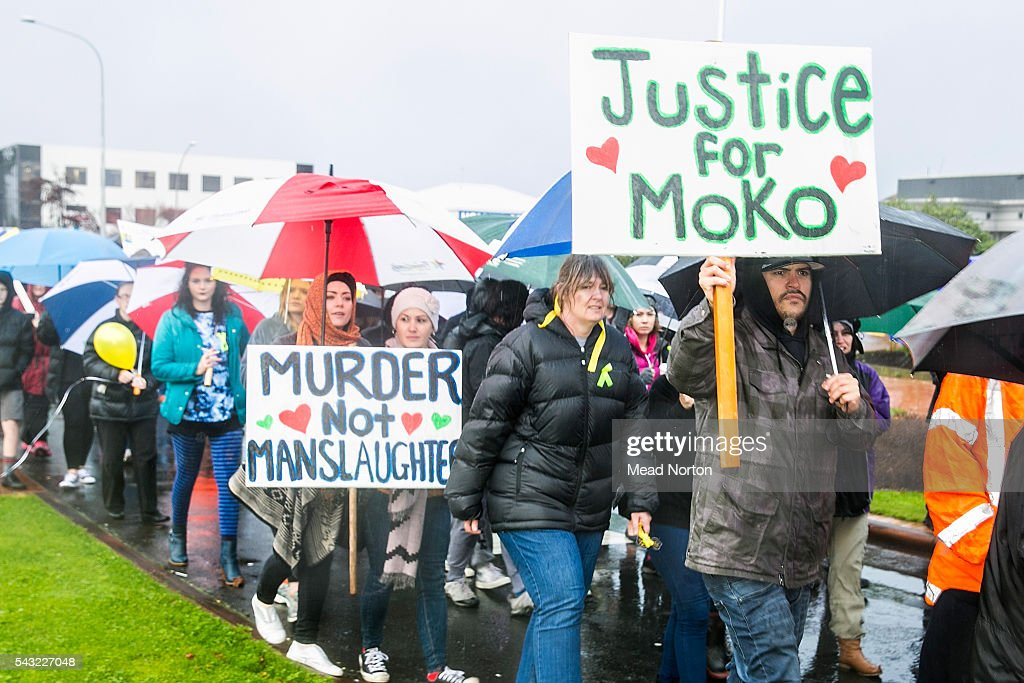 Protestors display their thoughts on the plea bargain cut for the people who ultimately killed baby Moko on June 27, 2016 in Rotorua, New Zealand. Three year old toddler Moko Rangitoheriri died on August 10, 2015 from injuries he received during prolonged abuse and torture at the hands of his carers. His killers Tania Shailer and David Haerewa were sentenced at Rotorua High Court today.